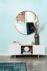 Adorable round mirror designs to brighten up your small space 39