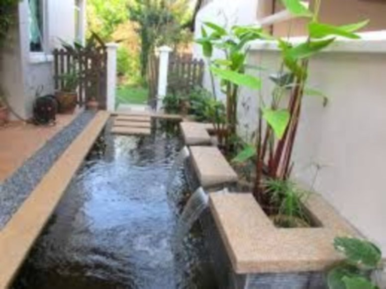 Design a fish pond garden with a waterfall concept 27