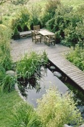 Design a fish pond garden with a waterfall concept 35
