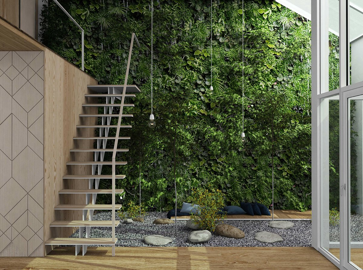A lush vertical garden reaches to the heights of the atrium and is easy to appreciate from the mezzanine level above to create warm impresion
