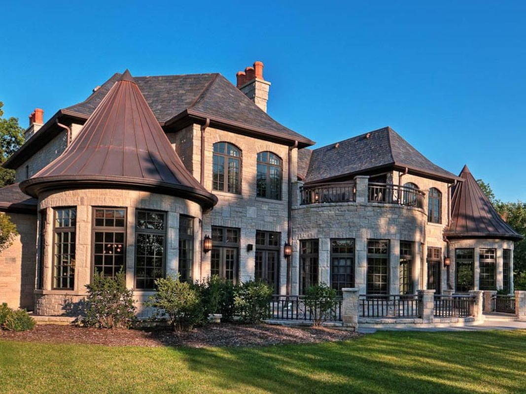 An amazing classic exterior with light grey stone walls, dark roof and classic window to perfect your classic home