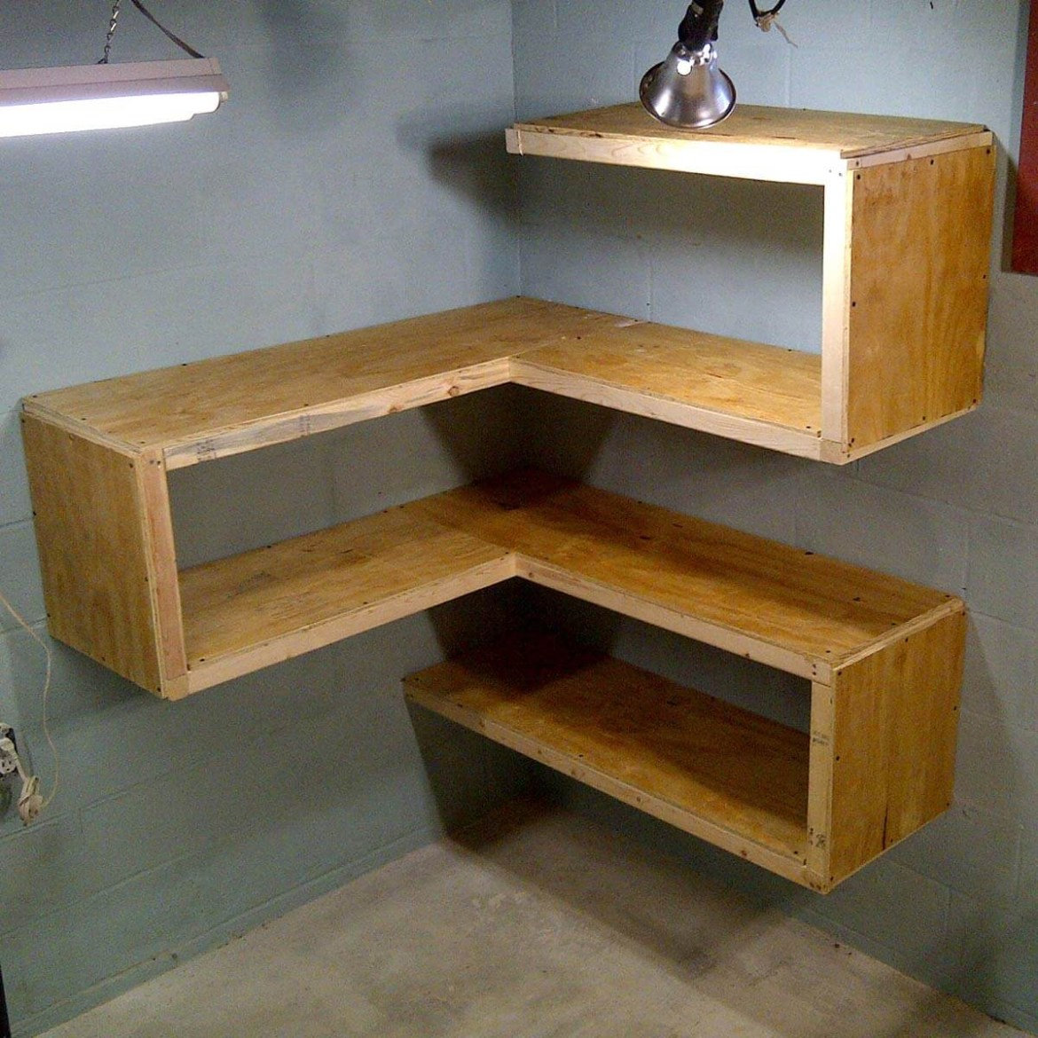 An awesome plywood furniture with flowing lines and interesting curves at the corner for bookshelves and storage