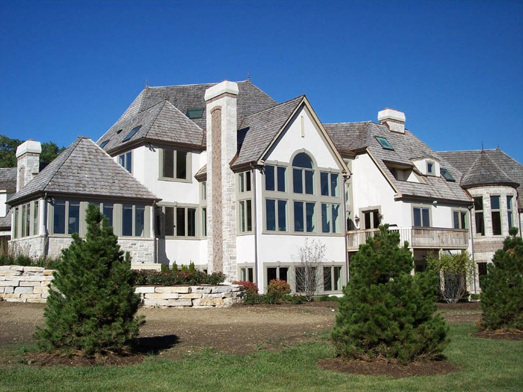 Beautiful classic exterior design with white walls, light grey roof and light grey windows to perfect your classic home