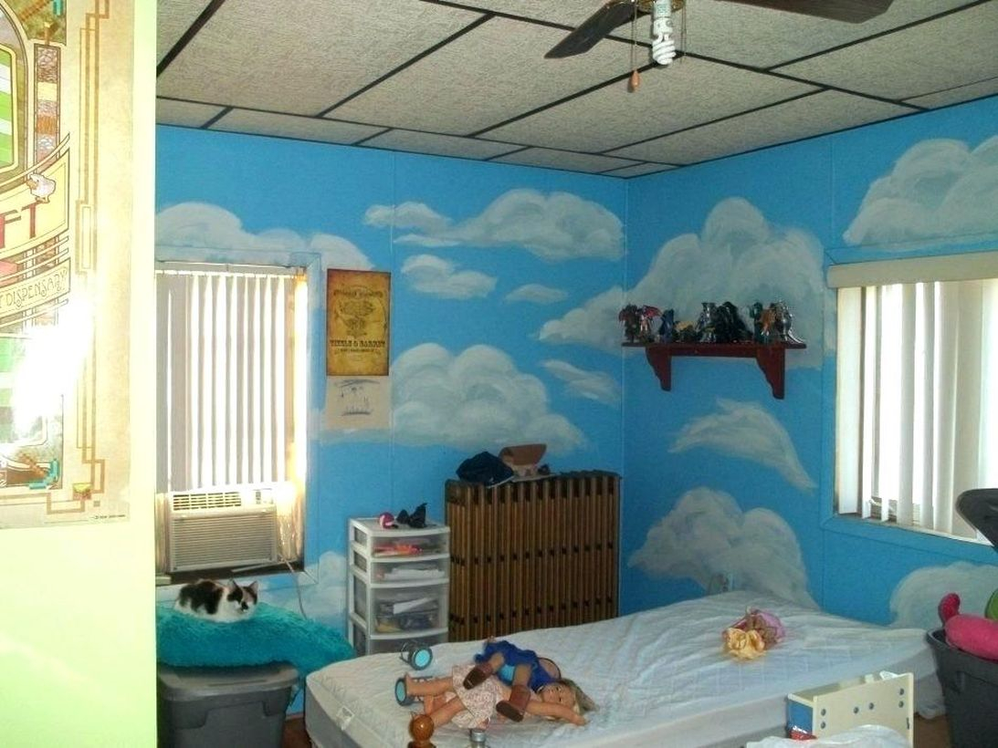 Beautiful blue children's room and white cloud motif with white windows, white curtains, white bedding