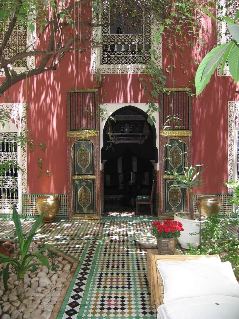 Boho exterior design with brown walls, mosaic floor for front yard and vines to beautify your home