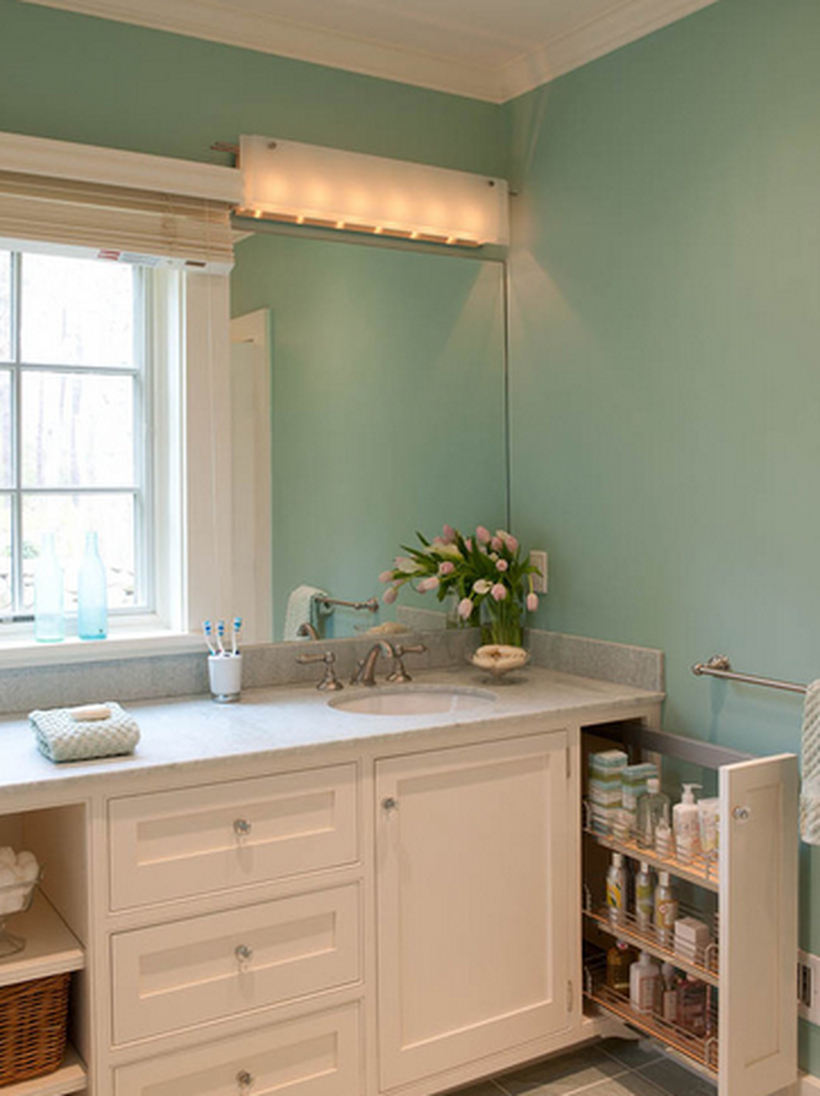 A creative bathroom storage ideas with hidden storage to store toiletries, a sink, and a window to create good lighting
