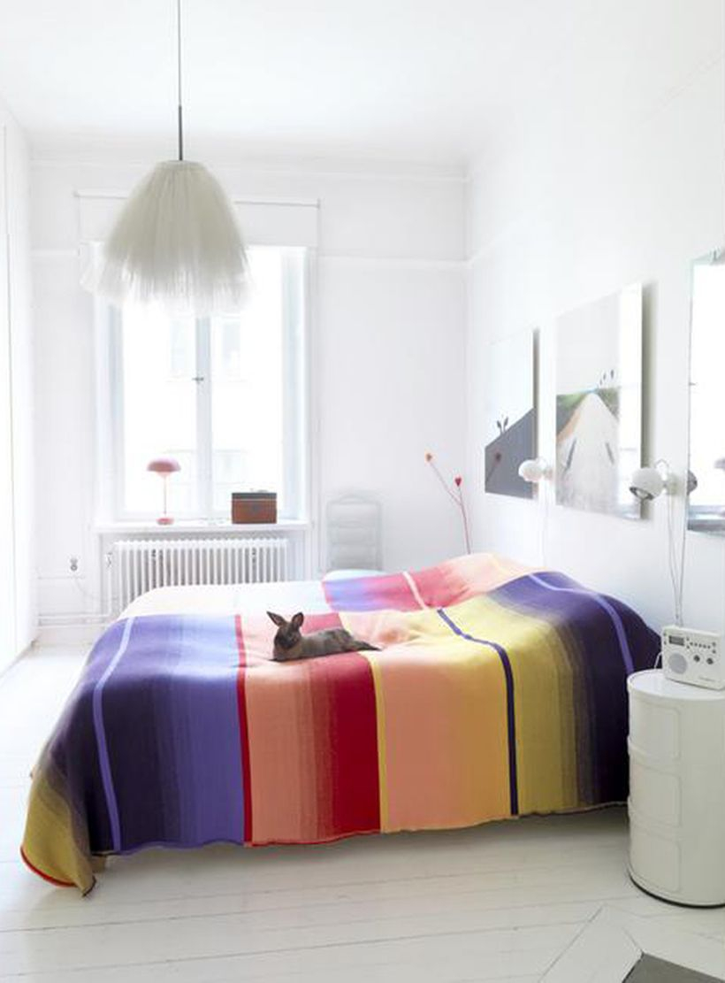 Awesome beds with splashes of color blankets, white beds, white walls, white floors for easy design rooms