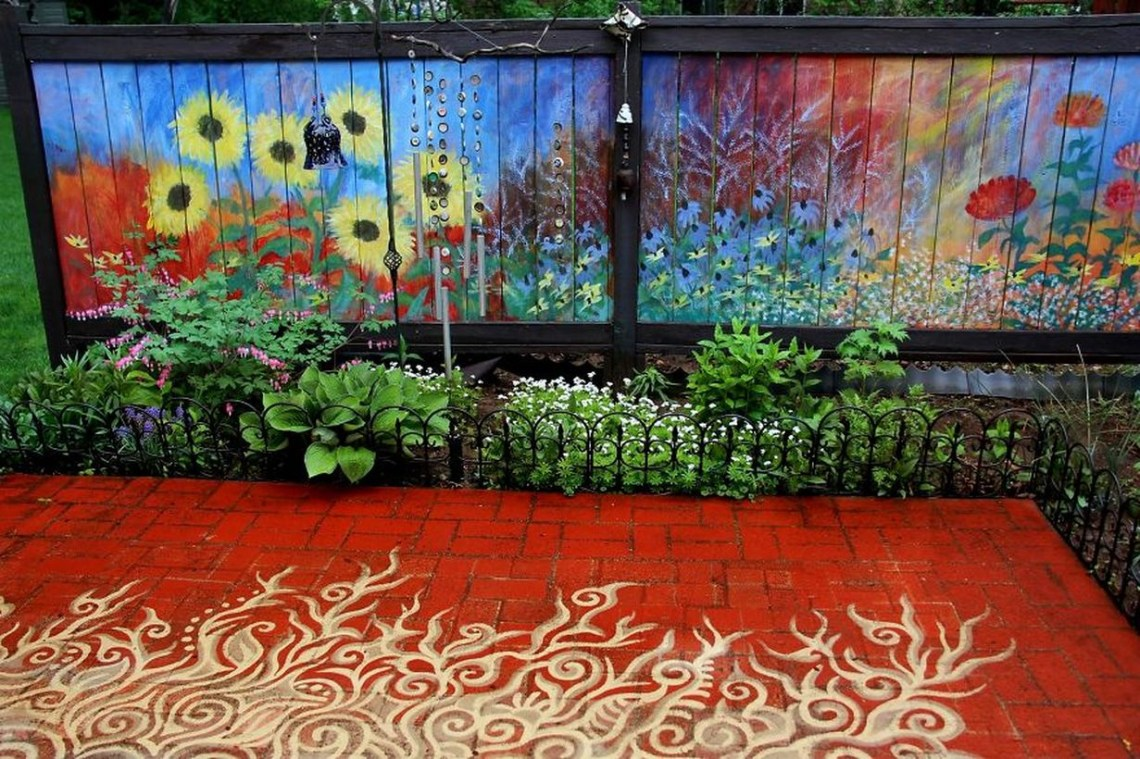 A beautiful painting fence for a garden with a full garden fence painted as a background in summer and also to add color to the landscape during the tedious winter months.