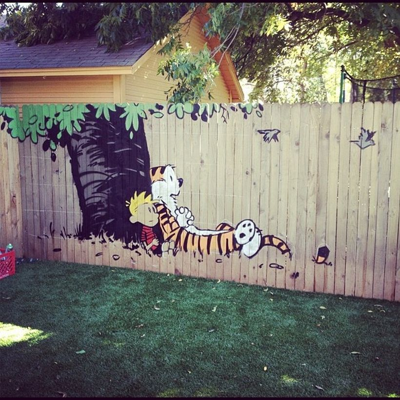 A creative painting fence for garden with calvin and hobbes murals that like the idea of scenes from childhood favorites played in the backyard.