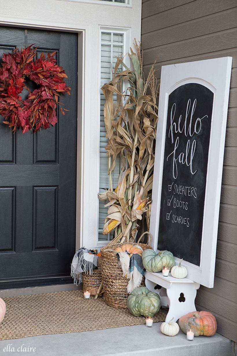 An amazing porch ideas fall welcome signs with wooden white whiteboard, pumpkins,candle lights, and red wreath