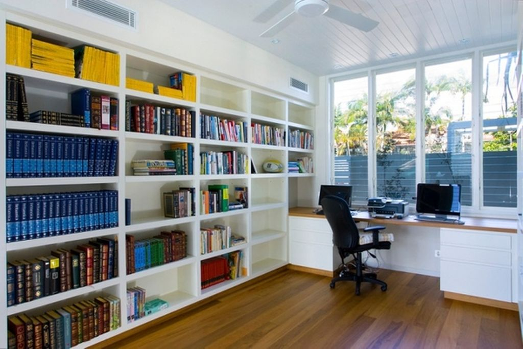 An amazing bookshelves in the side corner of the wall which are very large and accommodate several books to complete your home office