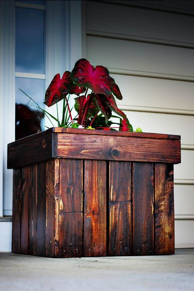 An amazing dark stained wood diy planter box to perfect your home decoration