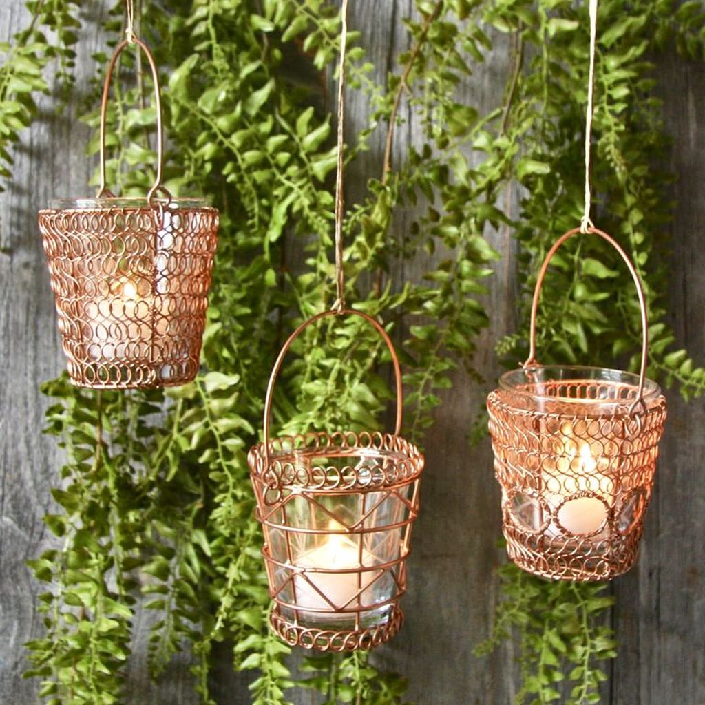 An amazing natural for home decor with hanging copper tea light holders to perfect your home