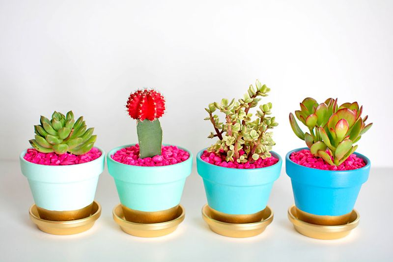 An amazing painted clay pots for garden with vertical design to beautify your garden
