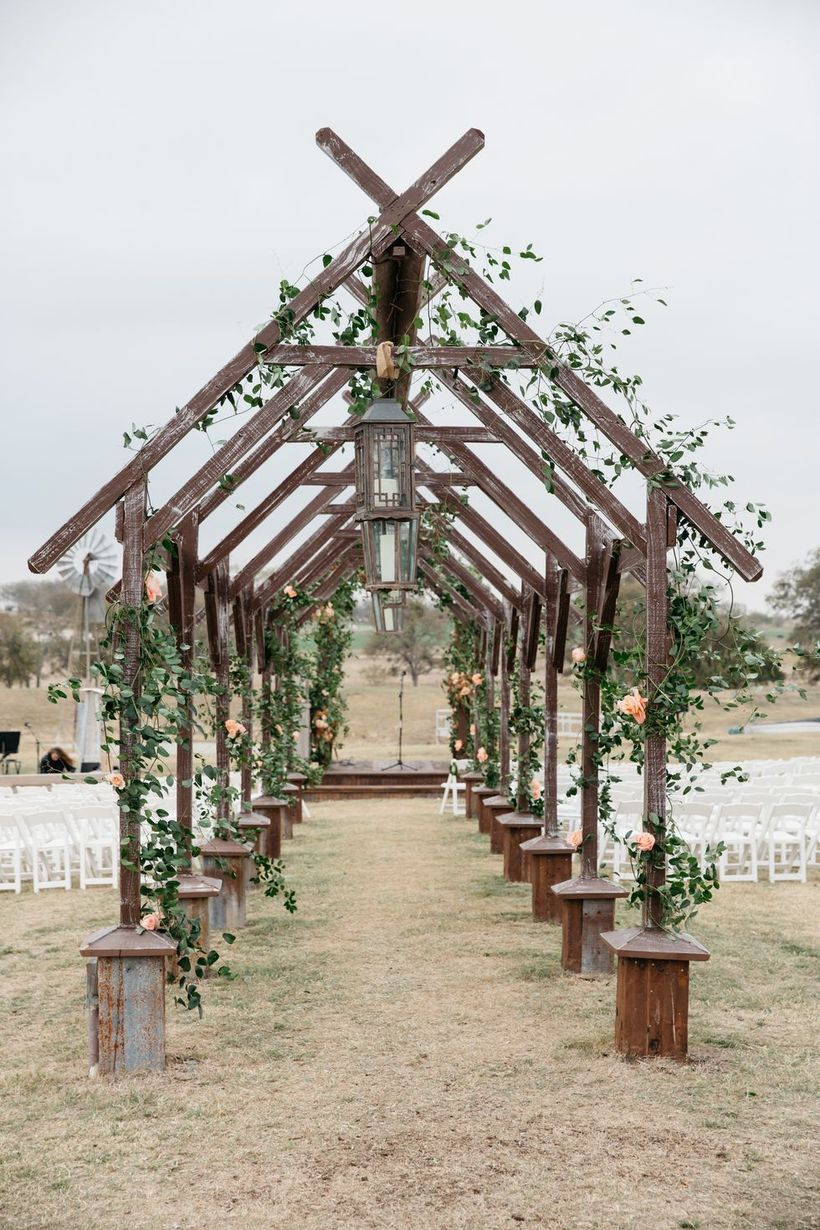 An exciting outdoor venue for fall wedding with this romantic rose-covered wooden archway perfect for walking down the aisle your wedding.
