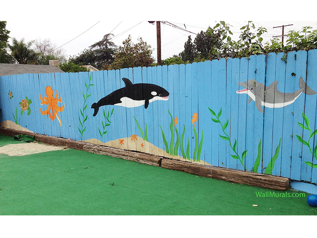 An exciting painting fence for garden with painting of sea animals that would brighten anyones day and make for a great playscape full of imagination.