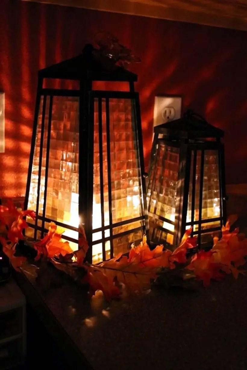 Arranged metal lantern with autumn fruits