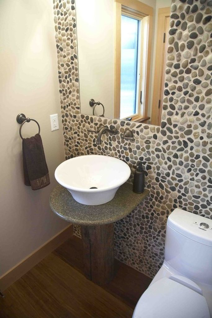 Beautiful bathroom design with river rock wall to bringing natural elements into your home