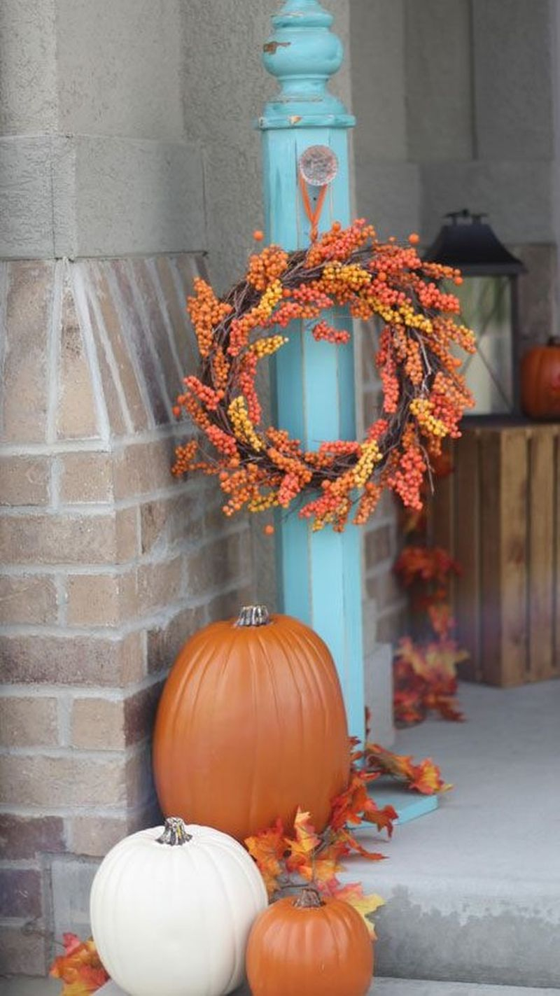 Beautiful outdoor decoration for fall combine with a bountiful fall wreath and faux pumpkins