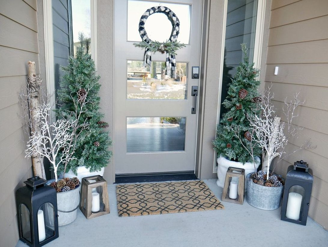 Best farmhouse porch ornament with plants in white pots, wooden candle lights to complete your front yard