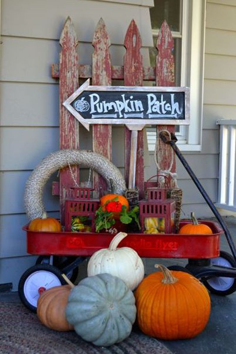 Cute fall decoration display using a repurposed little red wagon with room for tons of pumpkins, gourds, and antique finds