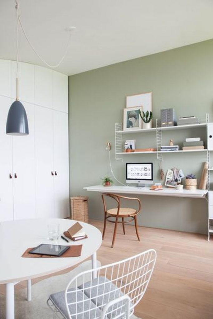 Lovely light green home office decoration combined with floating rack above table to perfect your neutral office home