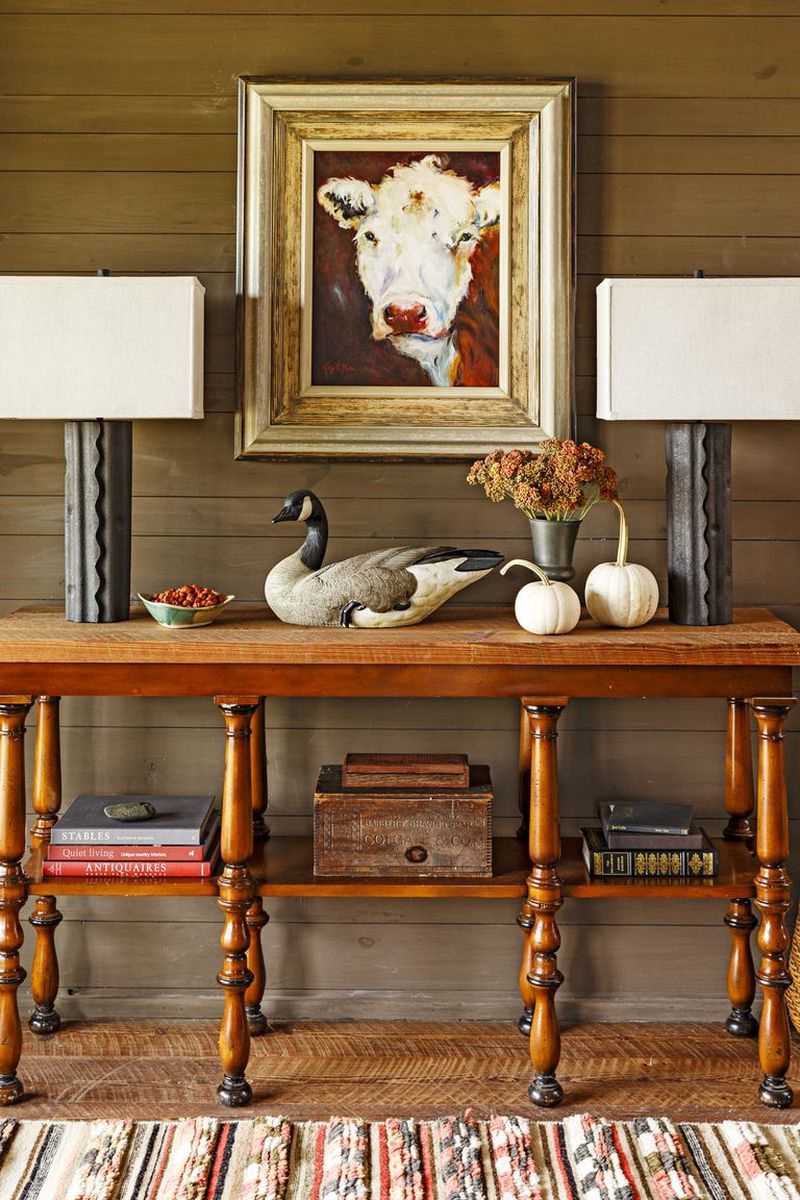 Place two small white pumpkins on an entryway table to greet guests in this fall season