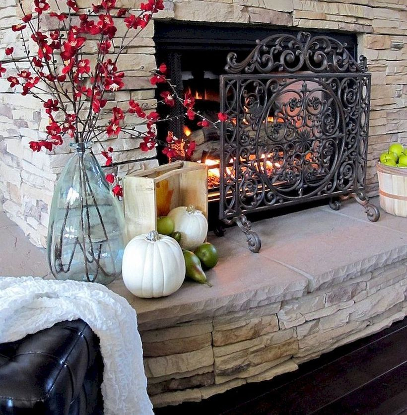 Red flowers and pumpkin fireplace decoration ideas