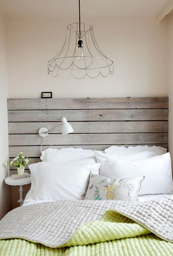 Small bed with wooden headboard