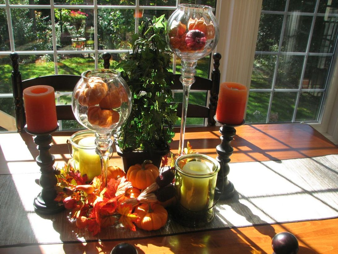 Small orange pumpkin and candle light centrepiece ideas