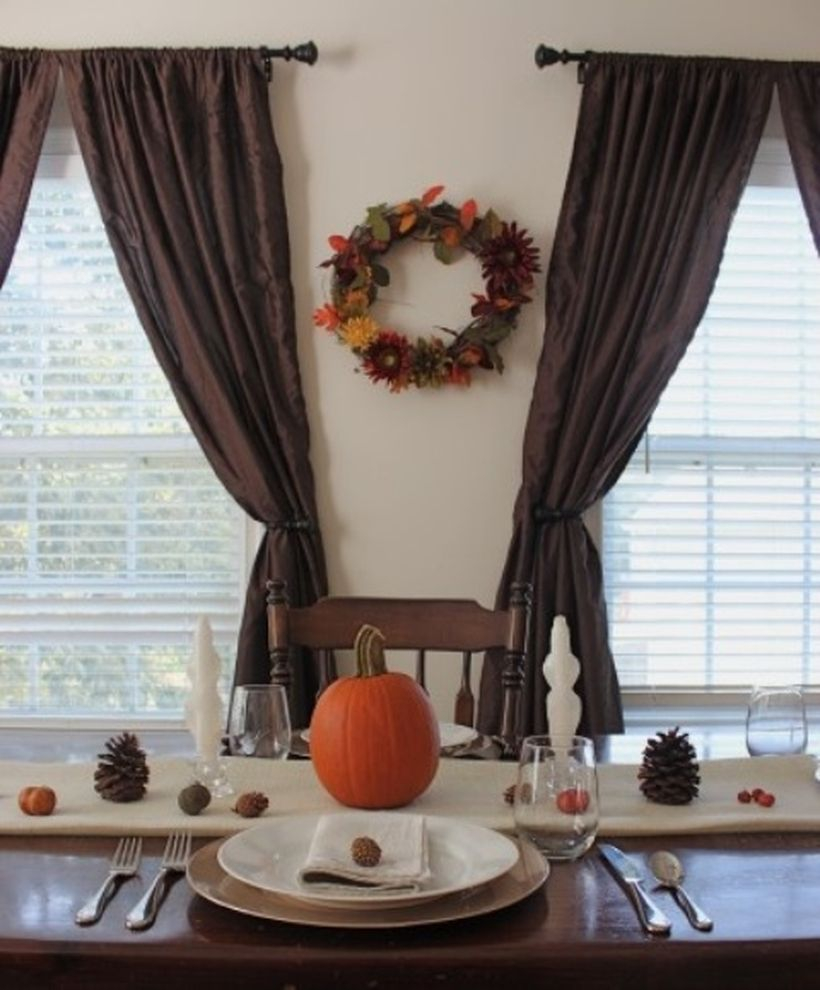 Cozy fall dining room decor ideas with pumpkins on dining table to create a your good mood