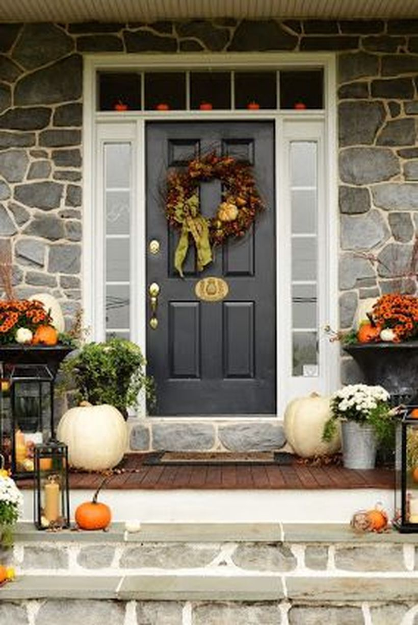 Fall porch decorating ideas with white and orange pumpkins decoration and pumpkin wreath you must try