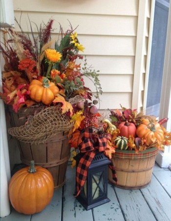 Flower arrangement using pumpkins and wood crates