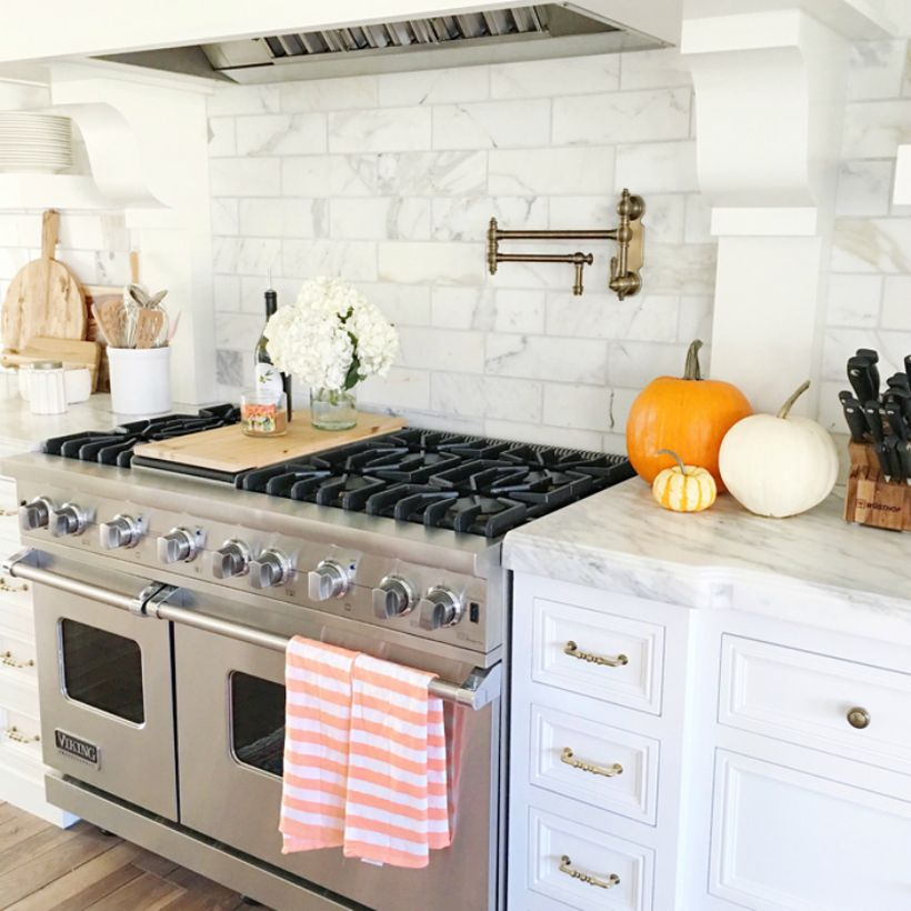 Pumpkins decoration on granite table kitchen to look fun this fall