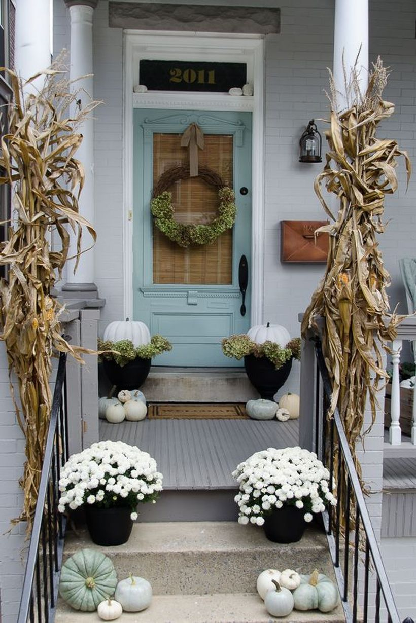 Stunning fall porch decorating ideas with white pumpkins used black pots and flower pots you must try