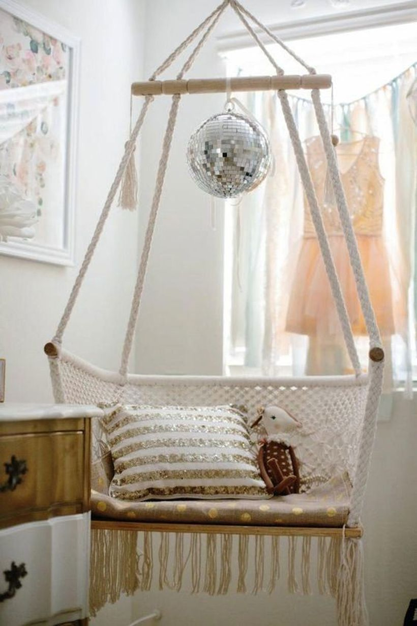 A hanging macrame chair for a kids' room.