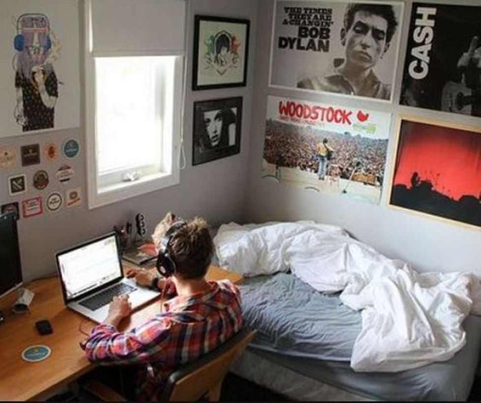 An amazing boys room decoration with gray mattress, white blanket, black photo decoration on the wall and wooden table for study