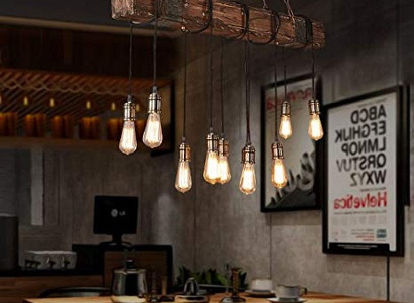 An attractive rustic chandelier for dining room with bubble chandelier adds drama to the dining room, buffet cabinet, wooden bench and wooden chairs. (2)