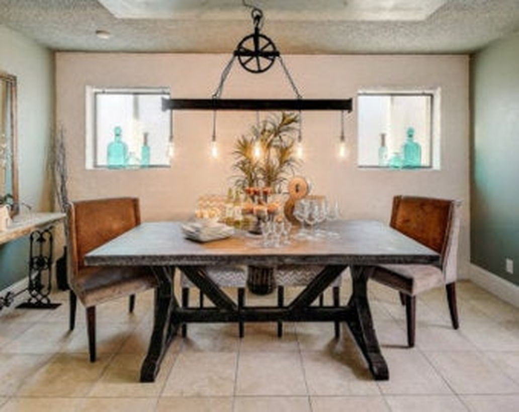 An awesome rustic chandelier for dining room with pendant chandelier, large table, leather chairs, small windows and decoration on the table.