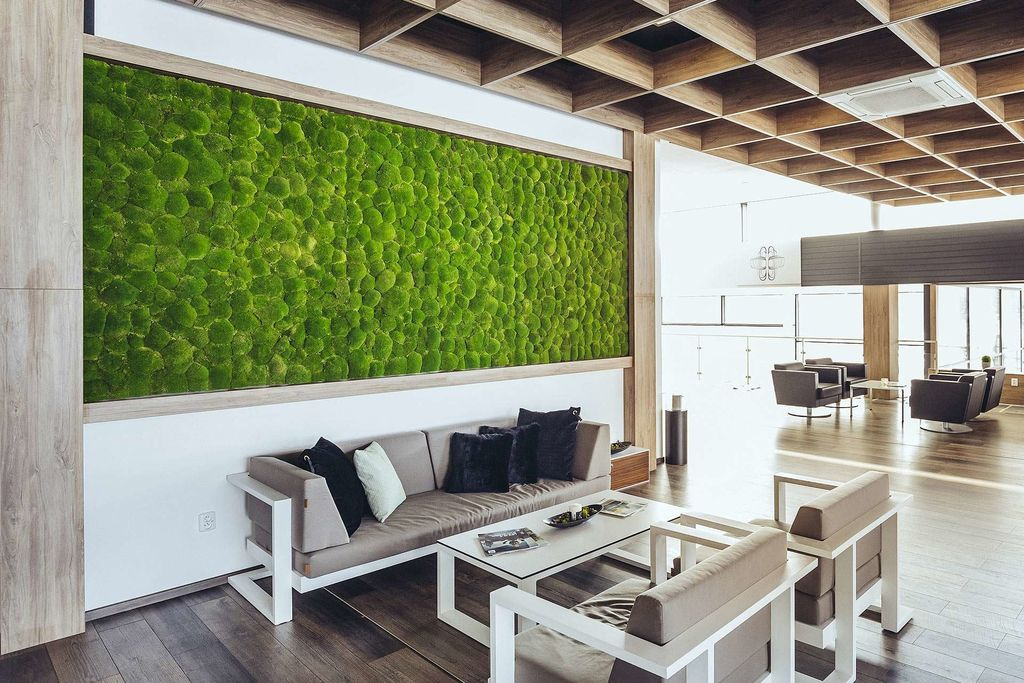 An elegant rustic living room design with wooden ceiling and wooden floor combined with moss wall behind the sofa to perfect your bathroom design