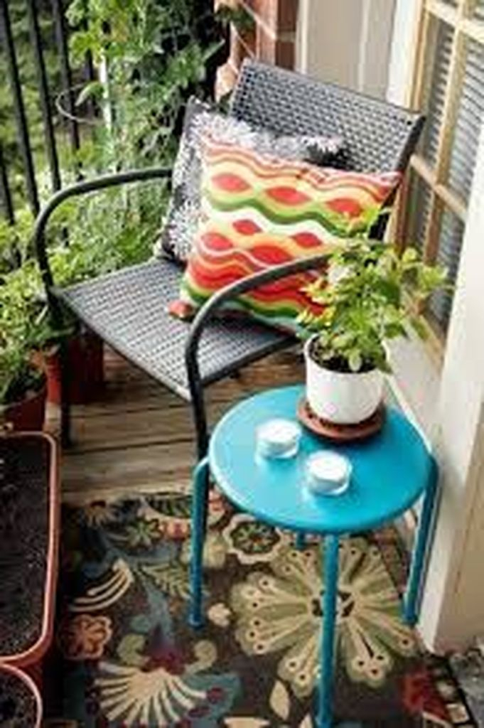 Blue table combined with rattan cahair to perfect your small balcony