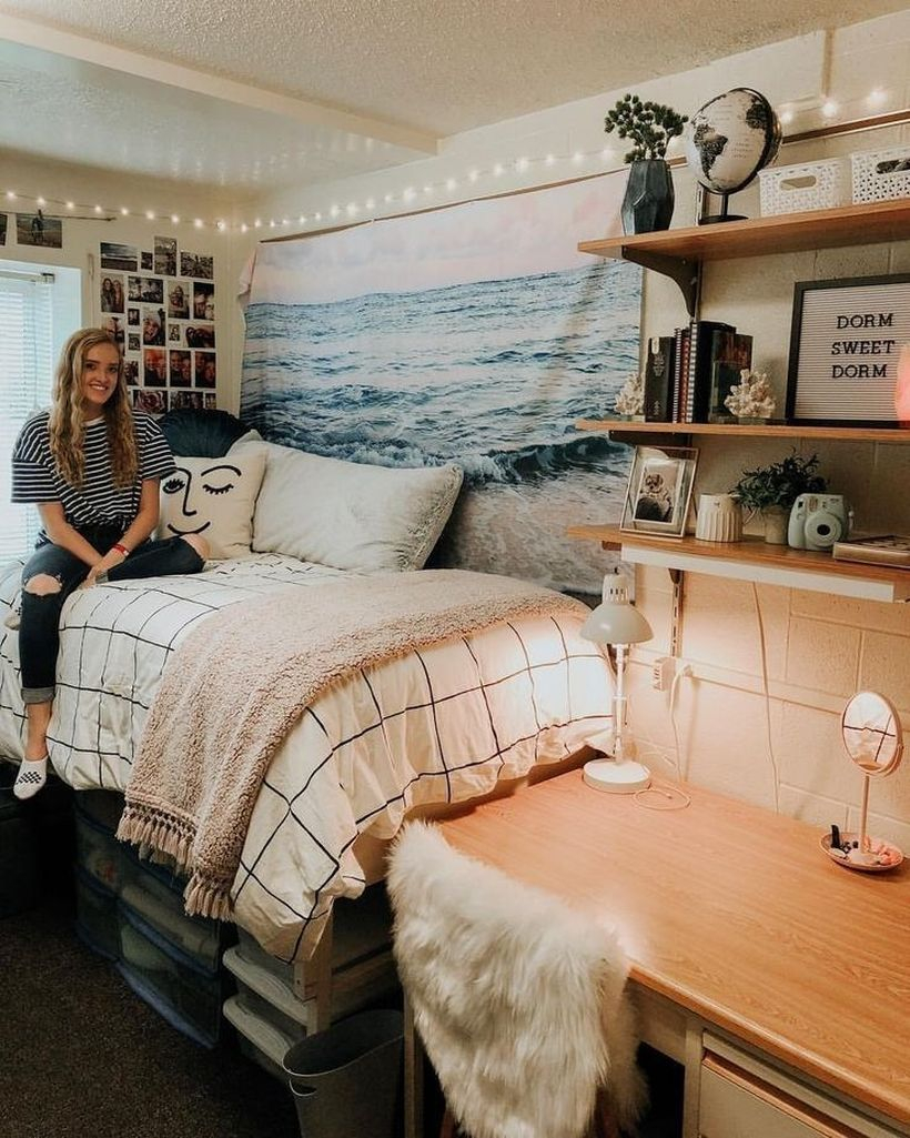 Cool girls room decor with white plaid bed, pink blanket, wall decorations made of fabric with pictures of the ocean and string lamps on the wall