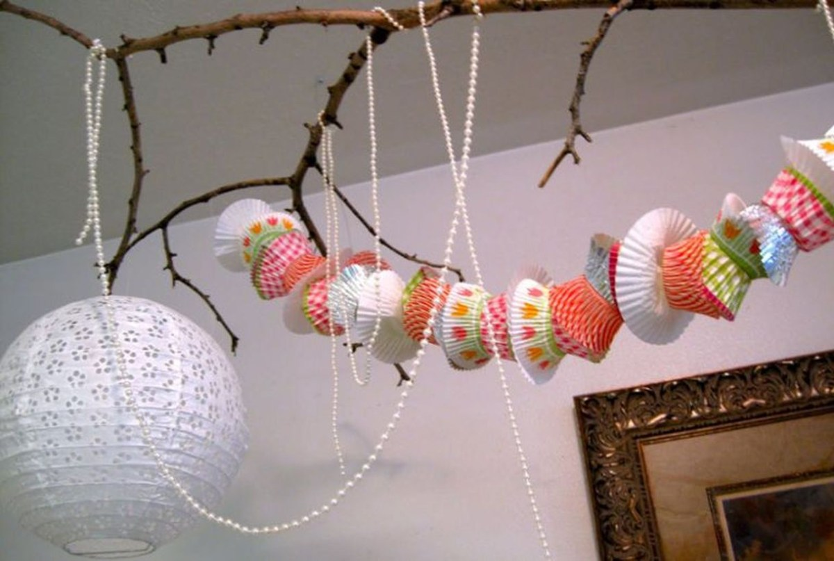 Creative ornament birthday party decoration with cupcake liner garland to look interesting