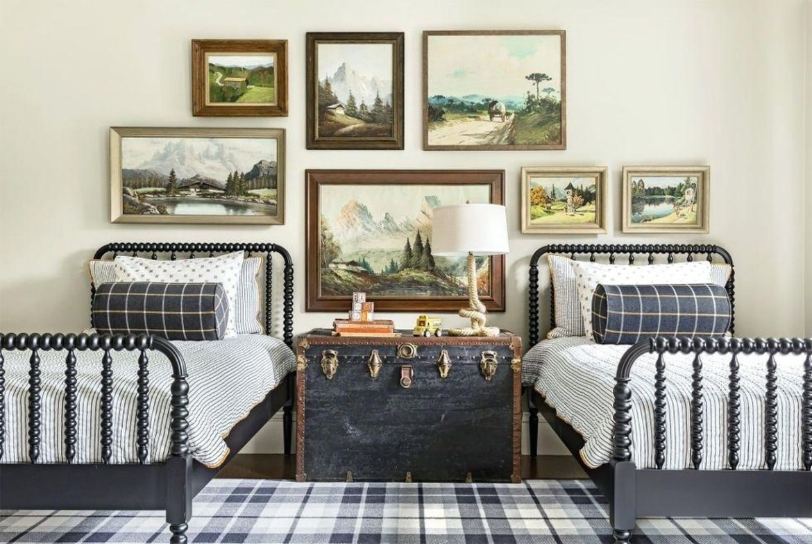 Creative boys room decoration with gray bed, black white striped mattress, white pillow, checkered carpet and decorative landscape painting on the wall