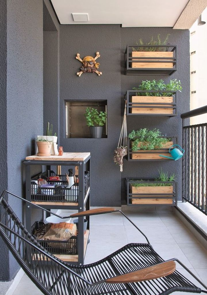Dark walls for small balcony combined with vertical garden on the wall