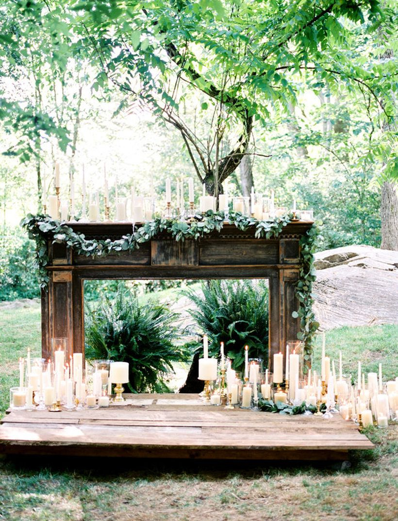 Fireplace mantels are the perfect opportunity for wedding candle decoration