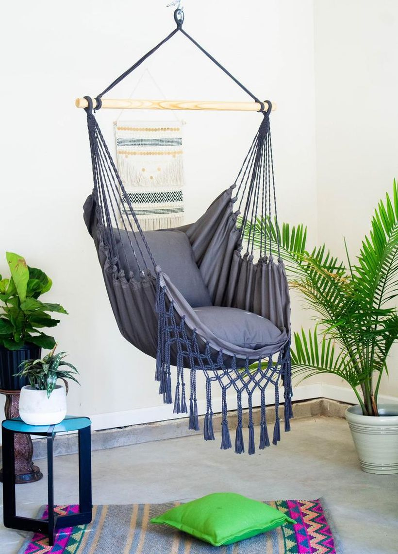 Gray macrame swing chair.