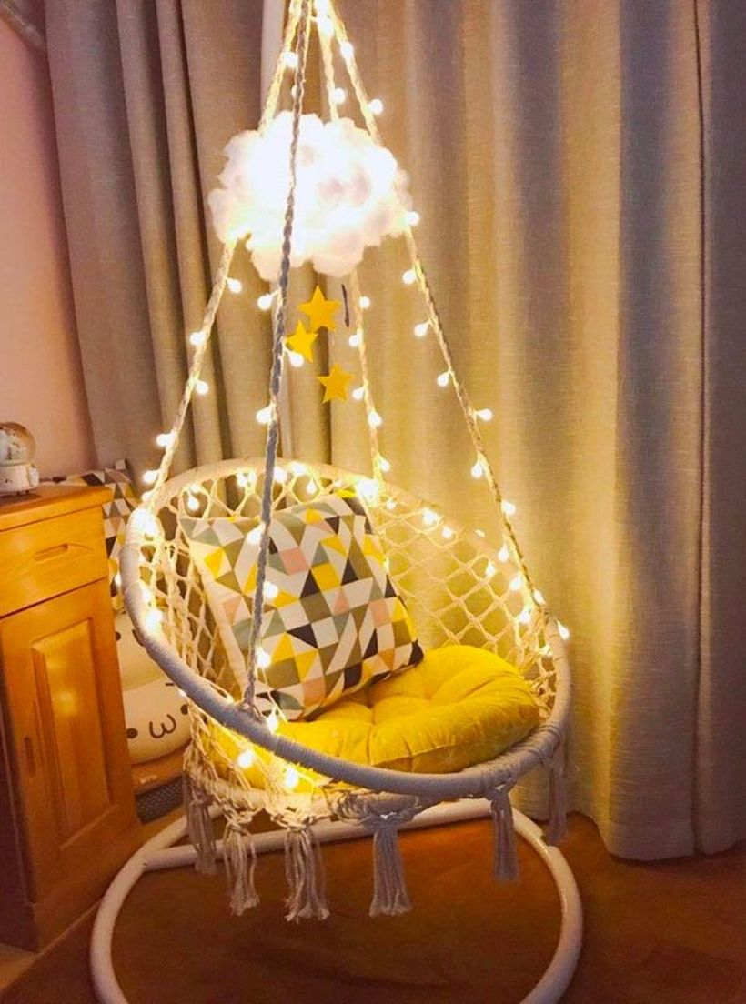 Hanging macrame chair with led lights.