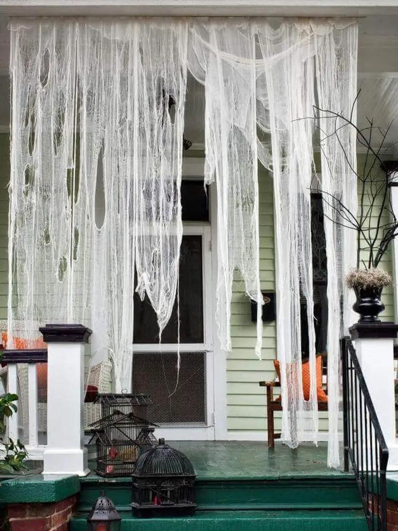 Hanging cobwebs halloween door.
