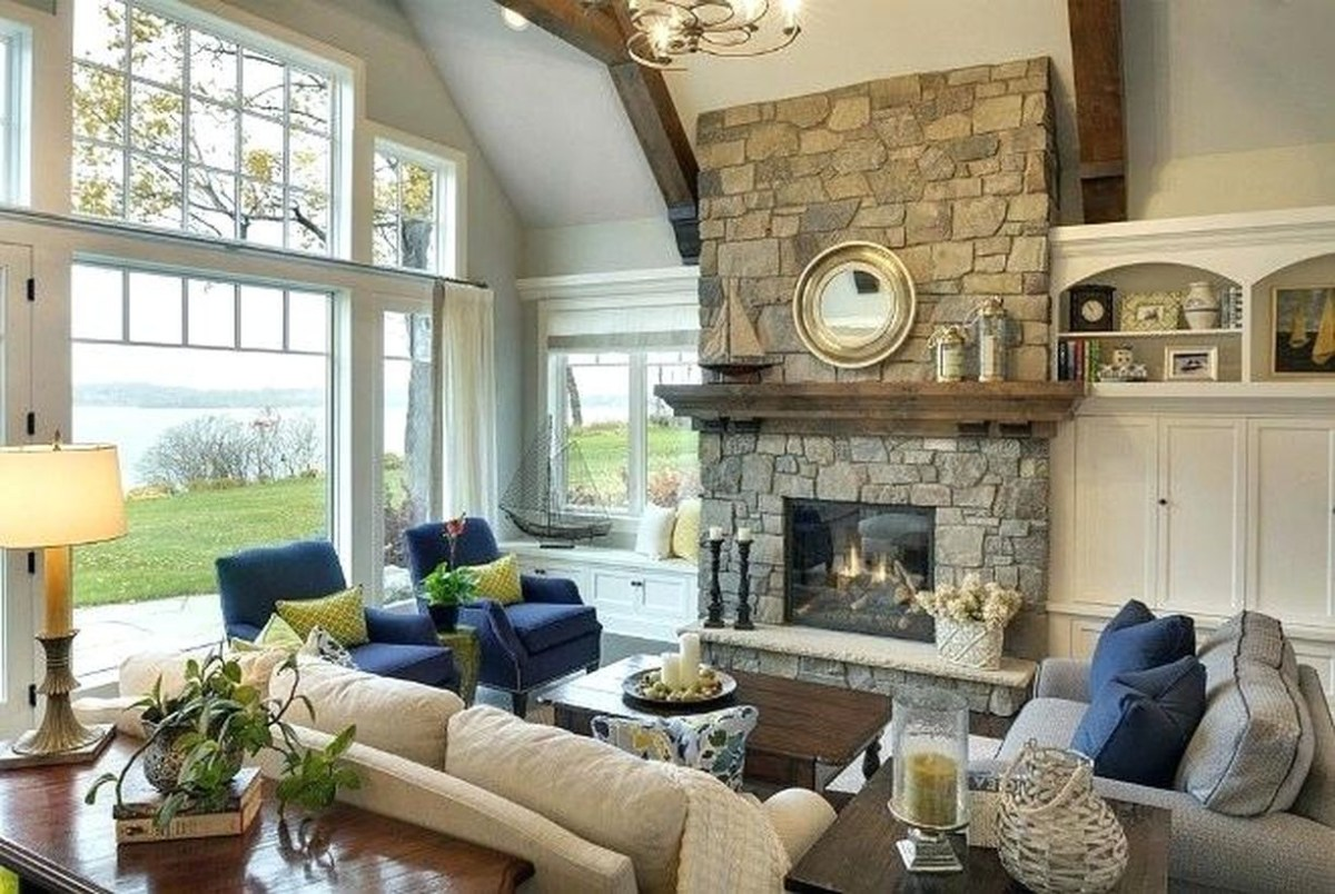 Lake house interior design with an amazing stone fireplace, to lift the atmosphere in your room, attach the elements to the gallery wall of the room or use it as a bookshelf accent to give family memories of eclectic chaos and add extra hard personal touches.